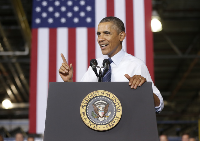 President Barack Obama speaks at the Ford Kansas City Stamping Plant in Liberty, MO., Friday, Sept. 20, 2013. Obama traveled to the Kansas City area to visit the Ford automotive plant as he contin ...