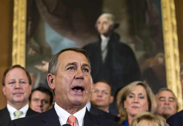 Speaker of the House John Boehner, R-Ohio and Republican members of the House of Representatives rally after passing a bill that would fund the government for three months while crippling the heal ...