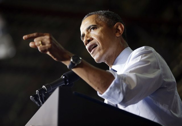 President Barack Obama gestures as he speaks to workers at the Ford Kansas City Stamping Plant in Liberty, MO., Friday, Sept. 20, 2013. Obama traveled to the Kansas City area to visit the Ford aut ...