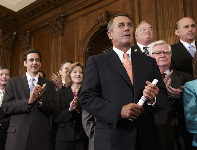 Speaker of the House John Boehner, R-Ohio, is cheered as Republican members of the House of Representatives rally after passing a bill that would prevent a government shutdown while crippling the  ...