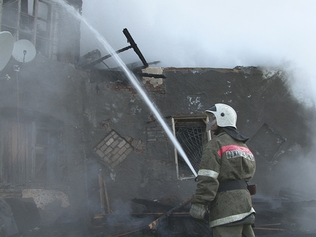 A firefighter works near a psychiatric hospital destroyed by fire in the Novgorod region town of Luka in this September 13, 2013 handout provided by the Russian Emergencies Ministry. The fire rage ...