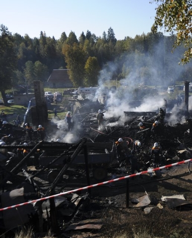 Russian Emergencies Ministry employees work amidst the debris of a psychiatric hospital destroyed by fire in the Novgorod region town of Luka September 13, 2013. The fire raged through the Russian ...