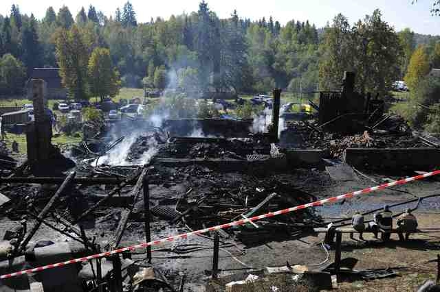 A view shows the debris of a psychiatric hospital destroyed by fire in the Novgorod region town of Luka September 13, 2013. A fire killed 37 people in a Russian psychiatric hospital on Friday, the ...