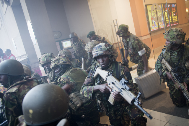 Armed police leave after entering the Westgate Mall in Nairobi, Kenya Saturday, Sept. 21, 2013. Gunmen threw grenades and opened fire Saturday, killing at least 22 people in an attack targeting no ...