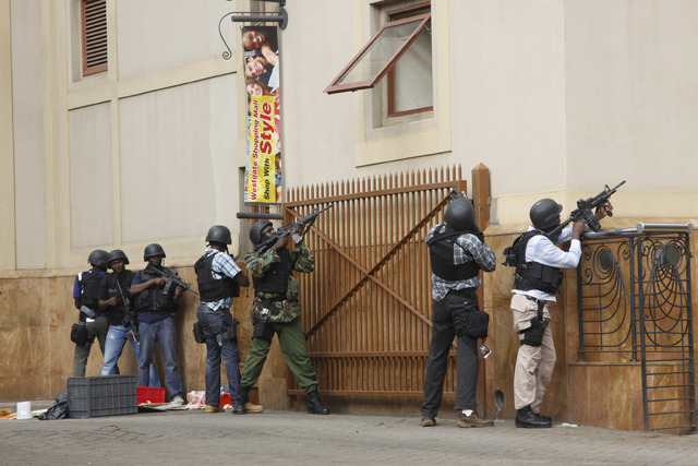 Armed special forces aim their weapons at the Westgate Mall in Nairobi, Kenya Saturday, Sept. 21, 2013, after gunmen threw grenades and opened fire during an attack that left multiple dead and doz ...