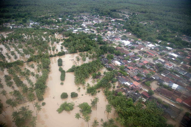 Aerial view of San Jeronimo, Mexico, after it was affected by rains and floods caused by Tropical Storm Manuel, Friday, Sept. 20, 2013. Federal police have been helping move emergency supplies and ...