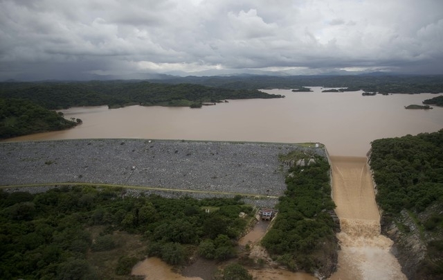 An aerial view of the hydroelectric dam of La Venta which provides power to the Guerrero State, near Acapulco,  Mexico, Friday, Sept. 20, 2013.  Many towns have yet to receive emergency supplies a ...