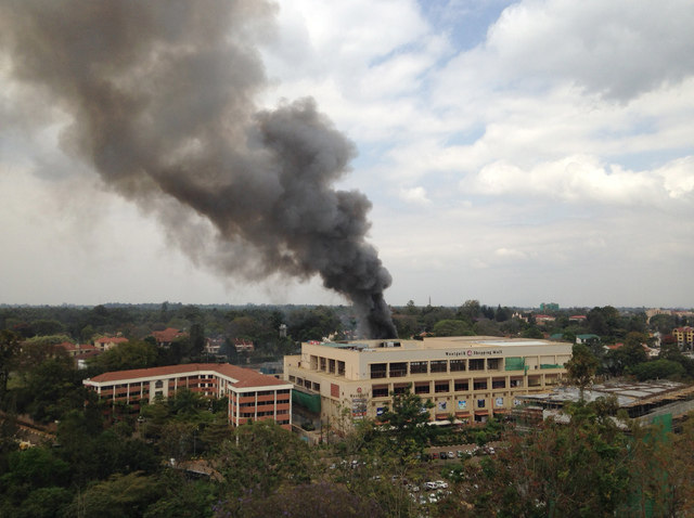Heavy smoke rises from the Westgate Mall in Nairobi, Kenya, on Monday. Multiple large blasts have rocked the mall where a hostage siege is in its third day. Security forces have been attempting to ...