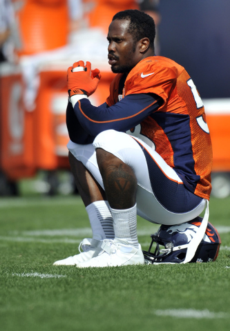 FILE - In this July 27, 2013, file photo, Denver Broncos linebacker Von Miller sits on his helmet during NFL football training camp in Englewood, Colo.  A person familiar with the case says Miller ...