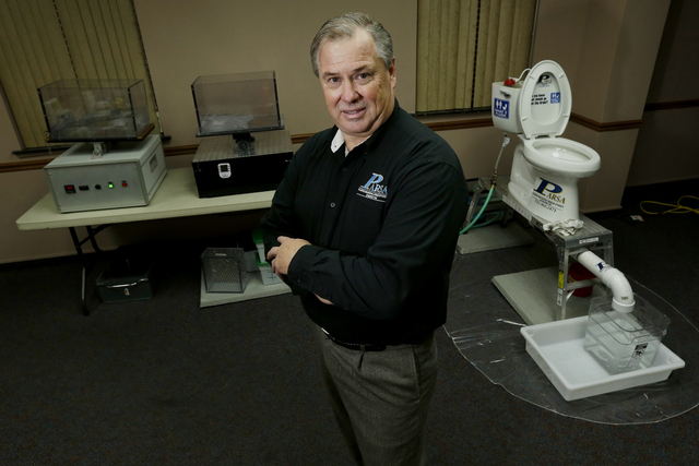 In this photograph taken, Friday, Sept. 20, 2013, in Middlesex, N.J., Rob Villee, executive director of the Plainfield Area Regional Sewer Authority in New Jersey, poses for The Associated Press w ...