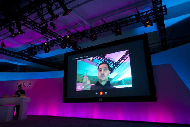 Panos Panay, left, corporate vice president of Microsoft, demonstrates the Skype interface on a Surface tablet, Monday, Sept. 23, 2013 in New York. Microsoft is introducing Monday new Surface tabl ...