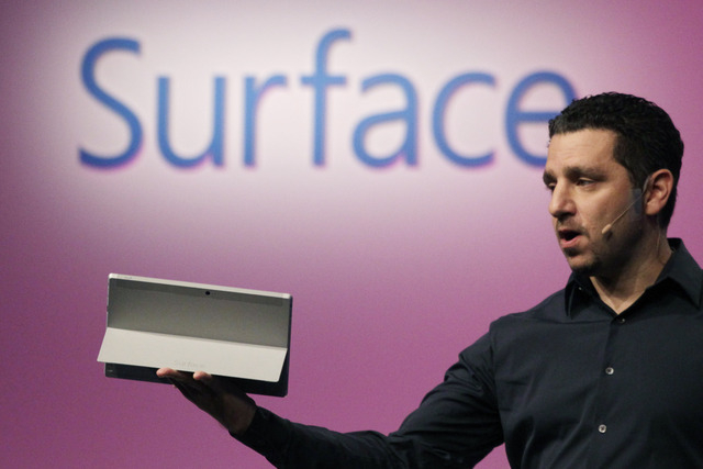 Panos Panay, corporate vice president of Microsoft, introduces a Surface 2 tablet with an integrated kickstand, Monday, Sept. 23, 2013 in New York. Microsoft says the Pro 2 also offers a 75 percen ...