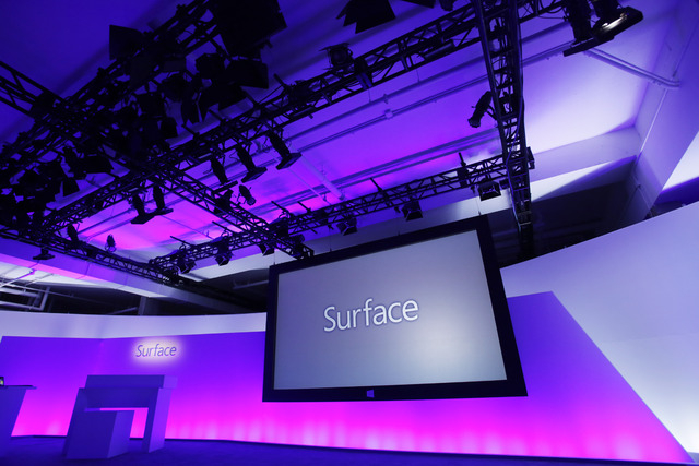 The Surface logo is illuminated on a stage prior to the introduction Microsoft's new Surface tablet computer, Monday, Sept. 23, 2013 in New York. Microsoft is introducing new Surface tablet comput ...