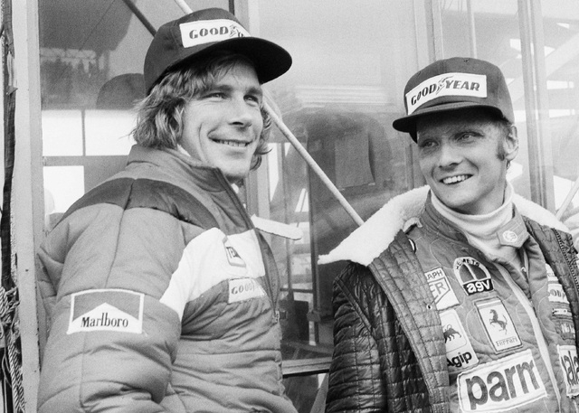 FILE - In this Oct. 24, 1976, file photo, Austrian auto racer Niki Lauda, right, defending champion in world driving, and James Hunt, of Britain, look at the rain before the start of the Japan Gra ...