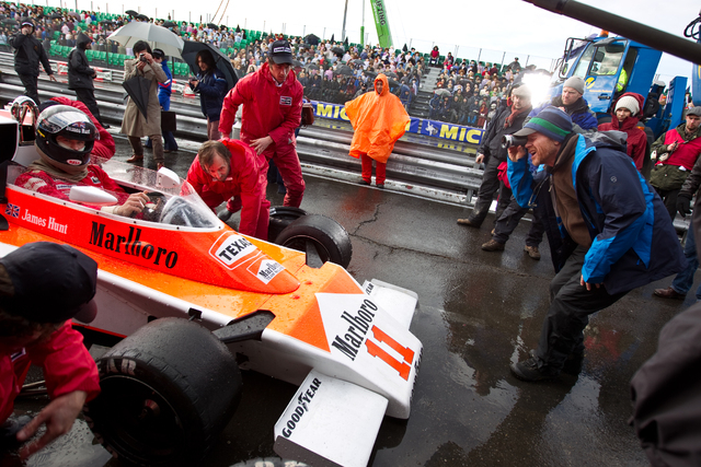 """This image released by Universal Pictures shows Chris Hemsworth, left, and director Ron Howard on the set of """"Rush.""""  The film, chronicling Formula One's 1976 world championship between  ..."""