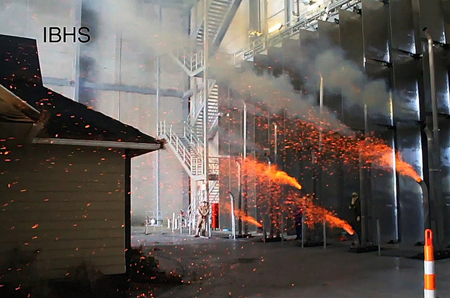 This frame grab from video shows embers being shot at a structure during a test at the Insurance Institute for Business and Home Safety test facility in Richburg, S.C., in April 2011. The National ...
