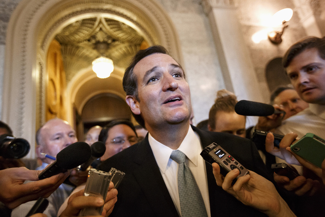 "Sen. Ted Cruz, R-Texas talks to reporters Wednesday as he emerges from the Senate Chamber on Capitol Hill after his overnight crusade railing against the Affordable Care Act, popularly known as ""O ..."