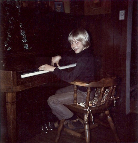 In this undated photo provided by Kim Cobain, a young Kurt Cobain plays piano in his childhood home in Aberdeen, Wash.  Cobain's mother, Wendy O'Connor, is putting the 1.5-story Aberdeen bungalow  ...