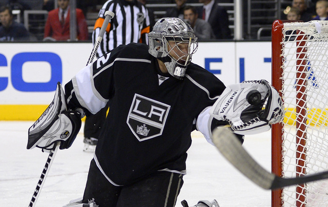 Los Angeles Kings goalie Jonathan Quick makes a glove save during the first period of an NHL preseason hockey game against the Anaheim Ducks, Tuesday, Sept. 24, 2013, in Los Angeles. (AP Photo/Mar ...