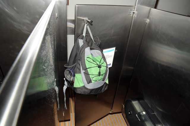This image from video provided by the FBI, shows Aaron Alexis' backpack that was found hanging on the back of a bathroom stall door in the fourth-floor men's bathroom in building #197 at the Washi ...