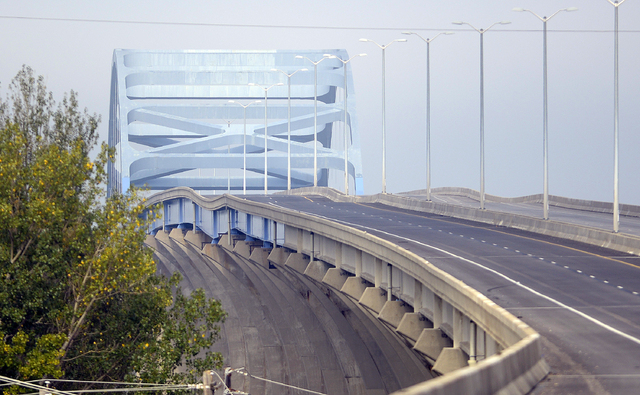 A span on the Leo Frigo Memorial Bridge in Green Bay shows signs of buckling Wednesday, Sept. 25, 2013 in this view looking west. Authorities say a section of the Interstate 43 bridge, about 150 t ...