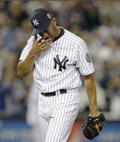 New York Yankees relief pitcher Mariano Rivera cries coming off the mound with two outs in the ninth inning of his final appearance in a baseball game at Yankee Stadium, Thursday, Sept. 26, 2013,  ...