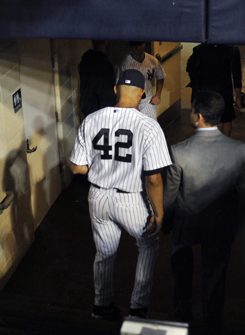 New York Yankees closer Mariano Rivera goes into the tunnel leading to the clubhouse after the Tampa Bay Rays defeated the Yankees, 4-0, in a baseball game Thursday, Sept. 26, 2013, at Yankee Stad ...