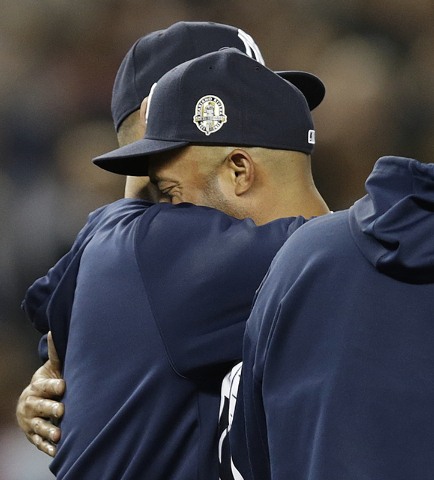 New York Yankees relief pitcher Mariano Rivera, right, embraces Yankees pitcher Andy Pettitte, who came out to the mound after Rivera's final pitching appearance in a baseball game at Yankee Stadi ...