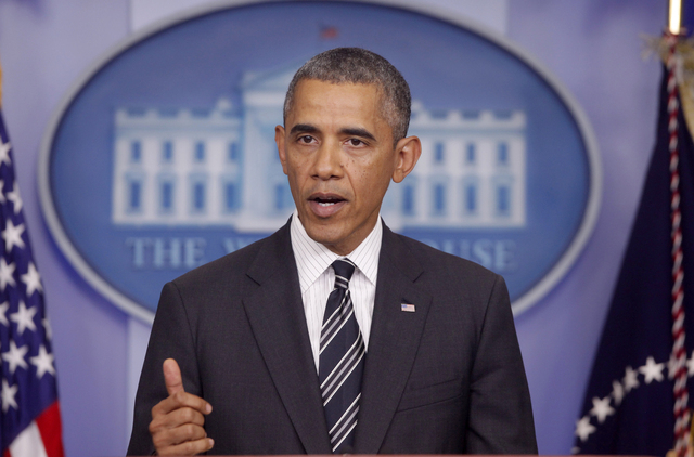 President Barack Obama makes a statement regarding the budget fight in Congress and foreign policy challenges, Friday, Sept. 27, 2013, in the James Brady Press Briefing Room of the White House in  ...