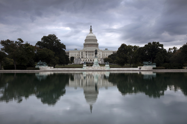 Storm clouds hang over Capitol Hill in Washington, Friday, Sept. 27, 2013, as the Republican-controlled House and the Democrat-controlled Senate stand at an impasse with Congress continuing to str ...