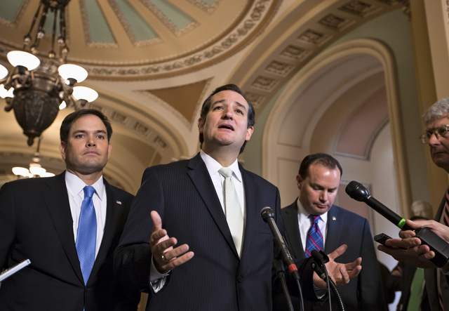 Sen. Ted Cruz, R-Texas, center, accompanied by Sen. Marco Rubio, R-Fla., left, and Sen. Mike Lee, R-Utah, right, express their frustration after the Senate passed a bill to fund the government, bu ...