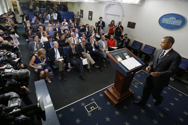 President Barack Obama arrives in the James Brady Press Briefing room of the White House in Washington, Friday, Sept. 27, 2013, to make a statement regarding the budget fight in Congress and forei ...
