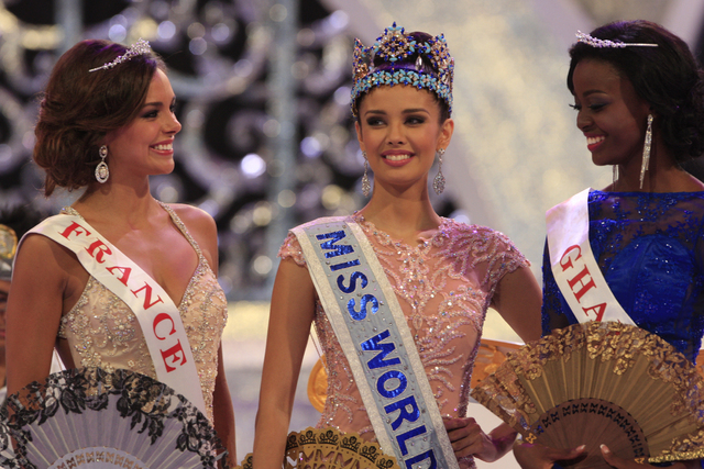 Newly crowned Miss World, Megan Young of Philippines, center, with second runner-up Miss France Marine Lorpheline, left, and third runner-up Miss Ghana Carranza Naa Okailey Shooter, smile after th ...