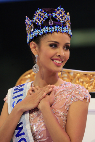 Megan Young of the Philippines smiles after being named Miss World 2013, during the grand final of the pageant,  in Nusa Dua, Bali, Indonesia, Saturday, Sept. 28, 2013. (AP Photo/Firdia Lisnawati)