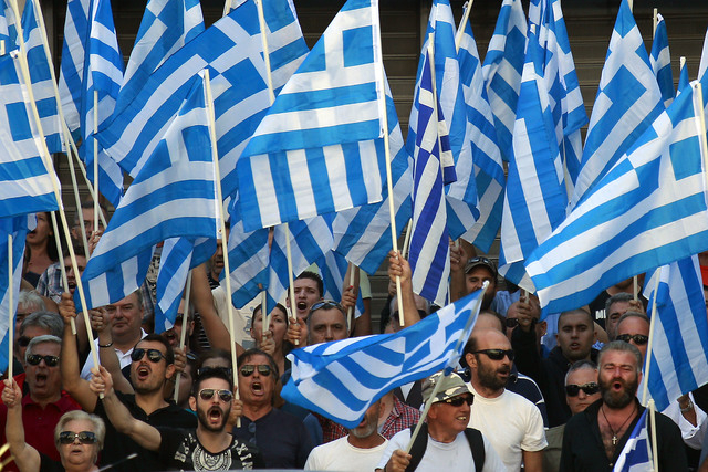 Supporters of the extreme far-right Golden Dawn party shout slogans during a protest in solidarity of the arrested lawmakers in front of the headquarters of Greek Police, in Athens, Saturday, Sept ...