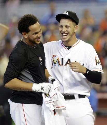 Miami Marlins starting pitcher Henderson Alvarez, left, and Jose Fernandez, right, celebrate Alvarez's no-hitter against the Detroit Tigers after an interleague  baseball game on Sunday, Sept. 29, ...