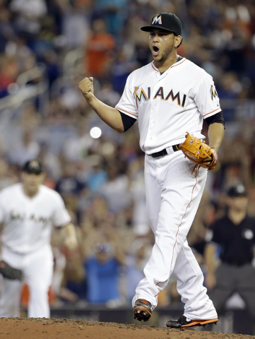 Miami Marlins' Henderson Alvarez celebrates after striking out Detroit Tigers' Matt Tuiasosopo for the last out of the ninth inning in an interleague  baseball game on Sunday, Sept. 29, 2013, in M ...