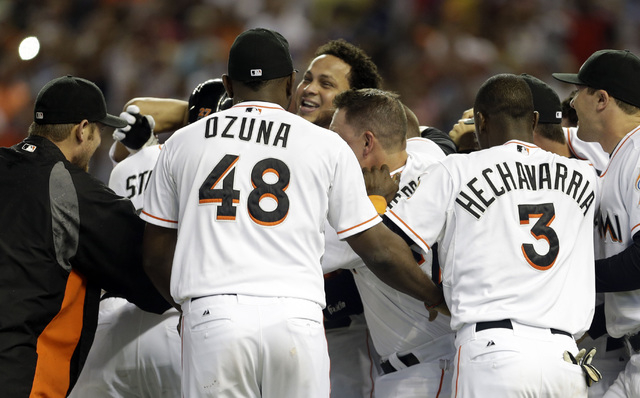 Miami Marlins' Henderson Alvarez, center, celebrates with teammates after pitching a no-hitter against the Detroit Tigers in an interleague  baseball game on Sunday, Sept. 29, 2013, in Miami. The  ...