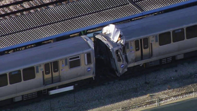 This image from video provided by NBC Chicago shows the aftermath of a crash involving two Chicago Transit Authority trains on the Blue Line during rush hour Monday, Sept. 30, 2013, in Forest Park ...