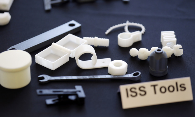 Tools and parts made by a 3D printer are displayed at Made in Space on Monday, Sept. 16, 2013, in Mountain View, Calif. One of the biggest obstacles to space exploration is that you need to bring  ...