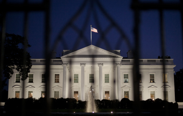 The White House in Washington is seen at night, Monday, Sept. 30, 2013. President Obama is ramping up pressure on Republicans to avoid a post-midnight government shutdown, saying a shutdown would  ...