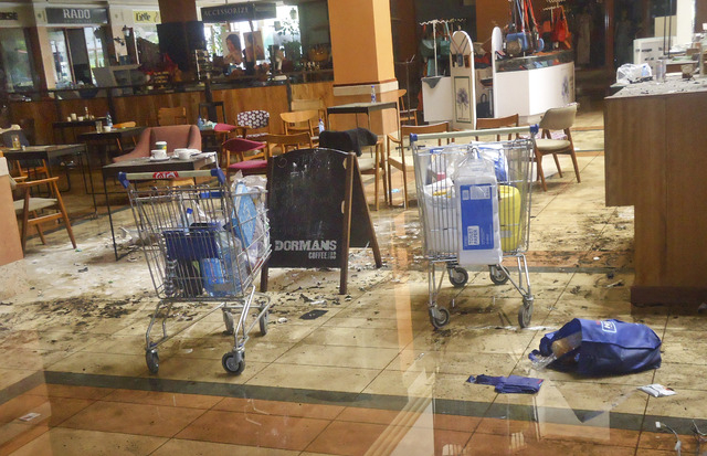 This photo taken Friday, Sept. 27, 2013 and made available Monday, Sept. 30, 2013, shows the scene at the Dormans coffee shop on the ground floor of the Westgate Mall in Nairobi, Kenya. The four-d ...