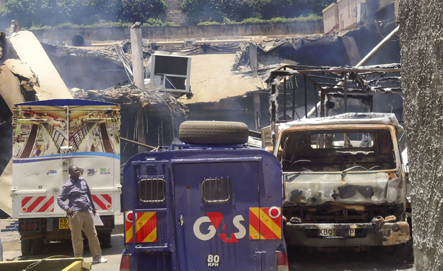 This photo taken Saturday, Sept. 28, 2013 and made available Monday, Sept. 30, 2013, shows burnt vehicles and the collapsed upper car park at the Westgate Mall in Nairobi, Kenya. The four-day sieg ...