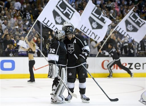 FILE - In this May 16, 2013 file photo, Los Angeles Kings center Anze Kopitar, of Slovenia,, right, celebrates their win with goalie Jonathan Quick in Game 2 of their second-round NHL hockey Stanl ...