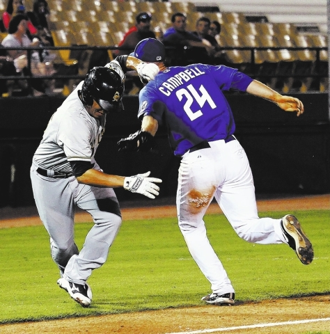 The 51s Eric Campbell tags out the Salt Lake Bees' Drew Heid during a rundown in between third base and home during game #3 of the Pacific Conference Championship Series in Las Vegas on Sept ...