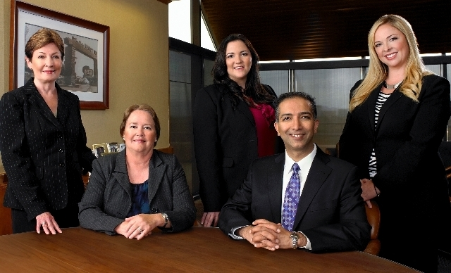 Bank of Nevada Executive Vice President and Regional Manager Daline Januik, seated, left, leads the lender's Healthcare Banking Group. Other Healthcare staff members are Ali Moosa, seated, r ...