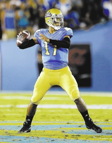 UCLA quarterback Brett Hundley throws against Nevada during the first half of an NCAA college football game in Pasadena, Calif., Saturday, Aug. 31, 2013. (AP Photo/Chris Carlson)