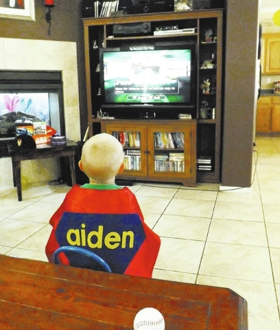 Aiden Hennigir, 4, wears a cape while playing video games at his home in Las Vegas on Sept. 3, 2013. Hennigir was diagnosed with retinoblastoma on Dec. 15, 2012. (Caitlyn Belcher/Las Vegas Review  ...