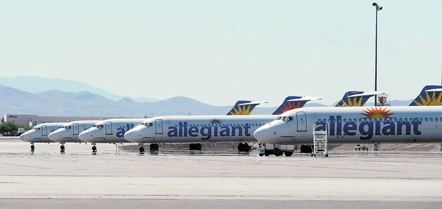 Allegiant Air MD-80s are lined up in a parking area at McCarran International Airport in Las Vegas, Friday, Sept. 20, 2013. Allegiant cancelled and delayed flights leaving McCarran as they checked ...