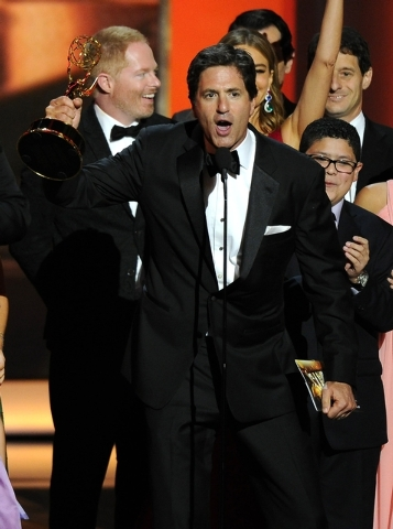 Steven Levitan and the cast and crew of Modern Family accept the award for outstanding comedy series at the 65th Primetime Emmy Awards on Sunday. (Chris Pizzello/Invision/AP)